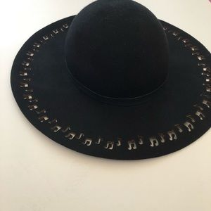 Black wide brim hat with cut out music notes
